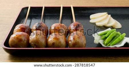Food and Cuisine, A Tray of Thai Grilled Sausages on Wooden Skewer Served with Ginger, Cabbage and Chili Pepper. - stock photo