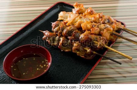 Food and Cuisine, Chicken Grilled or Barbecue Chicken on Bamboo Skewer Served with Spicy Sauce. - stock photo
