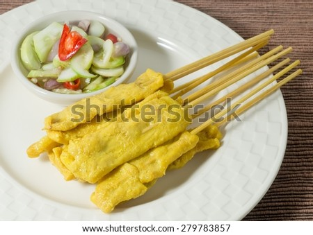 Food and Cuisine, Grilled Pork Satay on Bamboo Skewer Served with Cucumber Salad. - stock photo