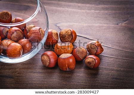 food and drink concept stack of hazelnuts in glass jar  - stock photo