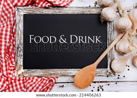 Food and drink written on chalkboard, close-up - stock photo