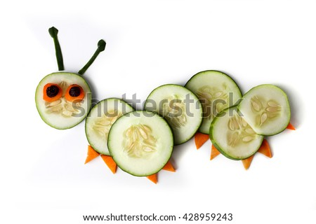 Food art creative concepts. Cute caterpillar made of cucumber and carrots isolated on a white background. - stock photo