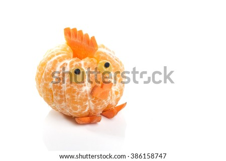 Food art creative concepts. Funny chicken made of  tangerine orange fruit, grapes and carrots.  - stock photo