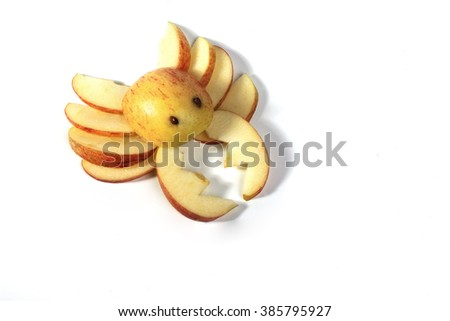Food art, delicious crab made of apples isolated on white background - stock photo