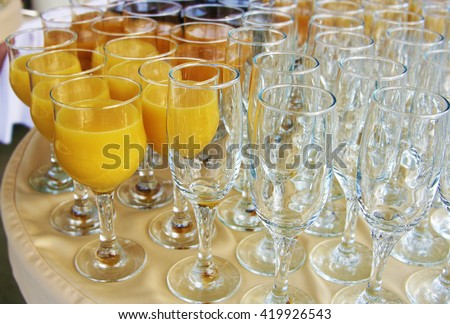 food background. many glasses with natural juice with orange on buffet table - stock photo