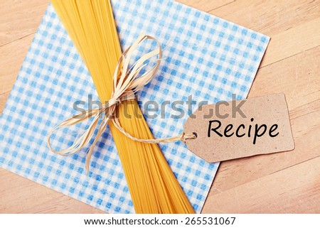 food background - pasta on wood table - stock photo
