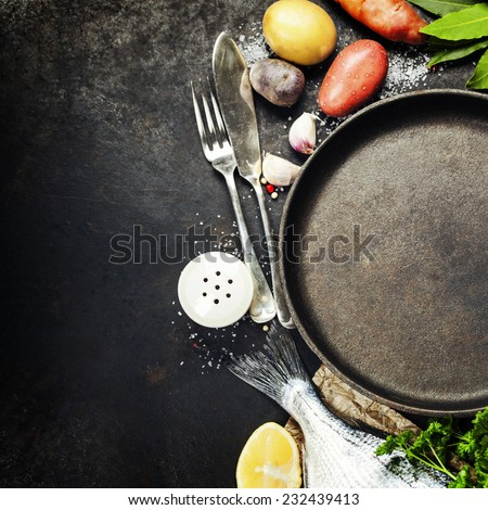 Food background with Fish and Vegetables. Lots of copy space - stock photo