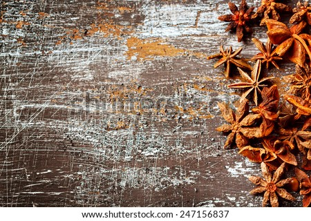 Food background with star anise close up on vintage black table. Selective focus on the right side. Space for text. - stock photo