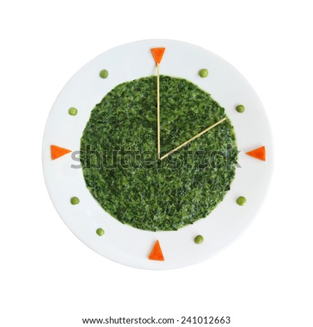Food clock - plate with creamed spinach for health nutrition concept  - stock photo