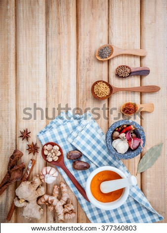 Food Cooking ingredients. Dried Spices herb cinnamon sticks,bay leaves,ginger,turmeric,nutmeg,chili,black pepper,fennel and saffron with the mortar on rustic wooden background. - stock photo