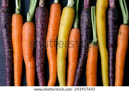 Food. Delicious carrot on the wooden table - stock photo