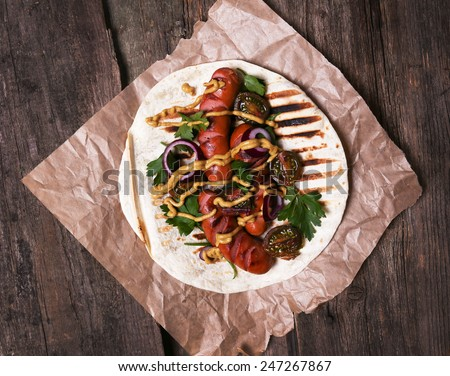 Food. Delicious, grilled sausages on the table - stock photo