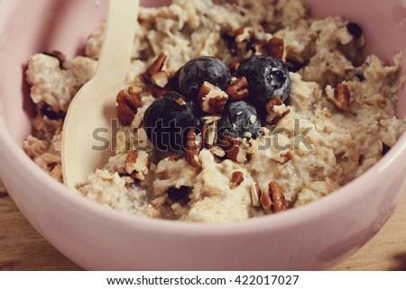 Food. Delicious oatmeal porridge with blueberries - stock photo