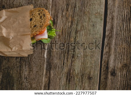 Food. Delicious sandwich on the table - stock photo
