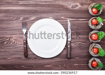 Food frame. Pasta ingredients. Cherry-tomatoes, garlic,  spices on dark grunge backdrop, copy space - stock photo