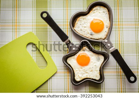 Food. Fried eggs in the form of star and heart. Flat lay, top view - stock photo