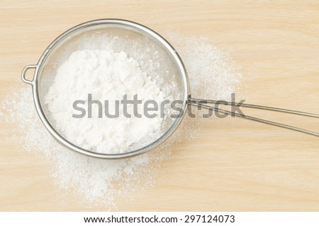 Food ingredient (flour) for backing (cake,dessert,sweet) on wooden background - stock photo