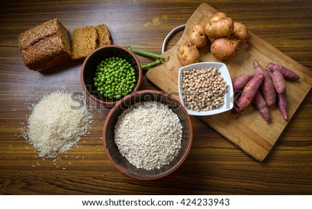 Food ingredient on wooden kitchen table - stock photo