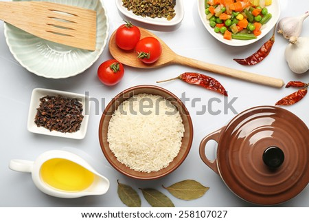 Food ingredients and kitchen utensils for cooking on white background - stock photo