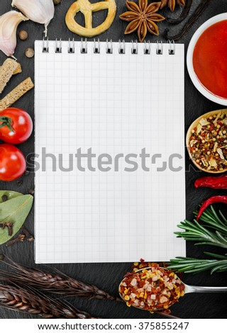 Food ingredients and recipe book on black background. Top view. Flat lay. - stock photo