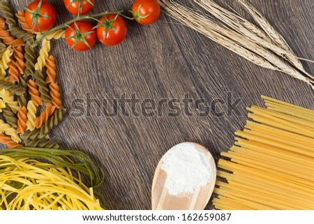 food ingredients and spices on wooden table - stock photo