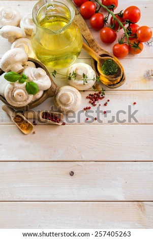 food ingredients for cooking vegetarian food on a wooden background - stock photo