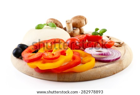 Food ingredients for pizza on cutting board isolated on white - stock photo