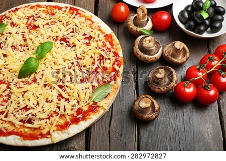 Food ingredients for pizza on table close up - stock photo