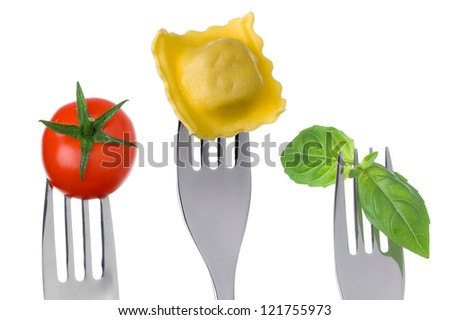 food ingredients of italy on forks against a white background - stock photo