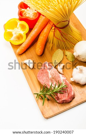 Food ingredients scattered around the cutting board. Isolated with light shadow. - stock photo