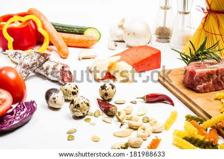 Food ingredients scattered around the white background. Isolated with light shadow. - stock photo