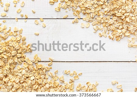 Food. Oats on the table - stock photo