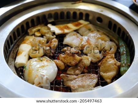 Food on Korean BBQ grill - stock photo