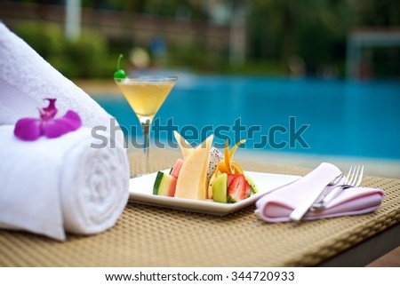 Food Plater with drinks on vacation at the swimming pool - stock photo