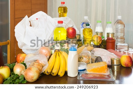 food purchases  on table in home - stock photo