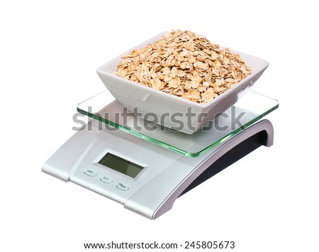 food scale with oatmeal bowl electronic and digital isolated on white background - stock photo