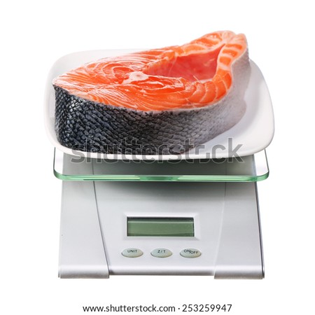 food scale with salmon fish electronic and digital isolated on white background - stock photo