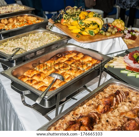 Food served on the table - a.k.a. swedish table: meat, rice, pasta, salads and fruit - stock photo