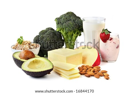 Food sources of calcium, isolated on white.  Includes milk, yogurt, almonds, cheeses, broccoli, salmon, and avocado. - stock photo