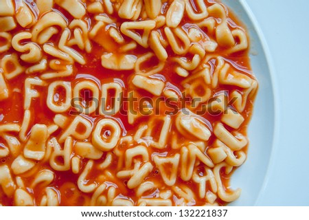 Food spelt out in Pasta and Tomato sauce - stock photo