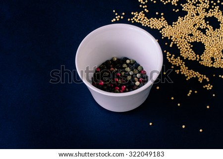 Food spice seasoning ingredients for cooking in cuisine on dark background. Dry powder curry, ginger, cardamon, rosemary. Asian  yellow, green colorful aroma condiment.   - stock photo