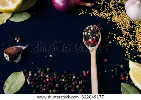 Food spice seasoning ingredients for cooking in cuisine on dark background in the wooden spoon. Dry powder curry, ginger, cardamon, chili, laurel. Asian  yellow, green colorful aroma condiment.   - stock photo