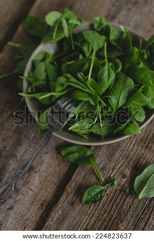 Food. Spinach on a wooden table - stock photo