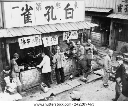 Food stall in post-World War II Tokyo has customers, but no rice. As late as the mid-1950's, Japan's economy was still recovering from defeat. Jan. 1954. - stock photo