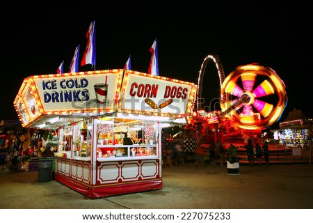 Food stand at a carnival at night - stock photo