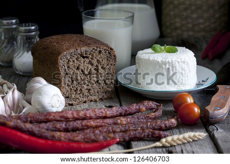 Food still life concept on vintage old retro wooden boards - stock photo