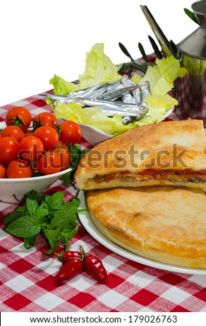 food stuffed with cherry tomatoes, basil and anchovies - stock photo