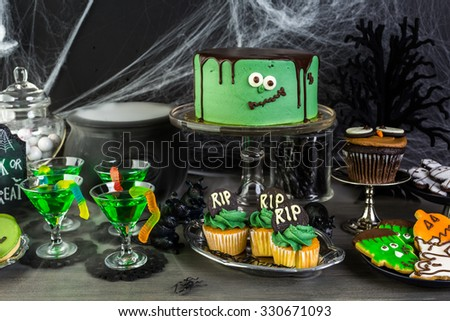 Food table arrangement prepared for Halloween party. - stock photo