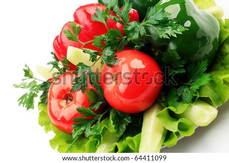 Food theme: fresh vegetables and greens on a plate. - stock photo