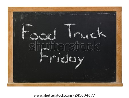 Food Truck Friday written in white chalk on a wood framed black chalkboard isolated on white - stock photo